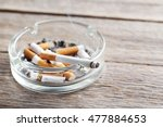 Cigarette Butts With Ash In...