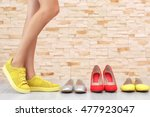 Woman Choosing Shoes On Brick...