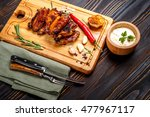 roasted chicken wings with herbs | Shutterstock . vector #477967117