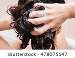 young woman washing hair with... | Shutterstock . vector #478075147