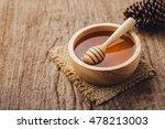honey with wooden honey dipper... | Shutterstock . vector #478213003