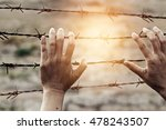 woman hands touch a rusty wire...   Shutterstock . vector #478243507