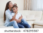 mother tenderly embracing... | Shutterstock . vector #478295587