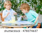 two twin boys having fun and... | Shutterstock . vector #478374637