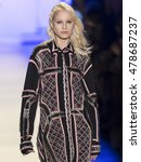 Small photo of New York City, USA - February 13, 2016: A model walks the runway during Herve Leger Women's show as a part of Fall 2016 New York Fashion Week