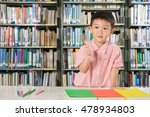 asian boy smiling in library... | Shutterstock . vector #478934803