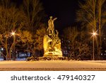 Small photo of Kronstadt, Russia - February 21, 2016: Monument to Admiral Makarov in Anchor Square in front of the Naval Cathedral of Saint Nicholas. Night winter scene.