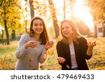 two friends throwing leaves and ... | Shutterstock . vector #479469433