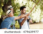 group of young friends fishing. | Shutterstock . vector #479639977