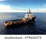 Small photo of Supply vessel with empty deck sailing for offshore cargoes