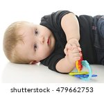 Small photo of Close-up of an adorable aby boy contentedly laying on the floor with his toy. On a white background.