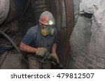 Miner In A Respirator With A...