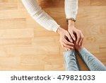 hands of woman supporting her... | Shutterstock . vector #479821033