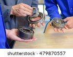 three men holding bearings | Shutterstock . vector #479870557
