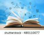 book on wooden table. icons on...   Shutterstock . vector #480110077