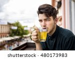 young man in a cafe drinking... | Shutterstock . vector #480173983