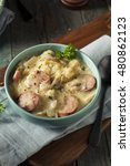 Small photo of Homemade Sauerkraut and Sausage Soup with Potatoes and Parsley