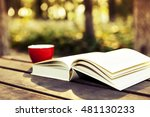 books and coffee mugs  wooden