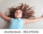 Small photo of Little girl with hair all over the place
