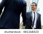 two businessmen shaking their... | Shutterstock . vector #481268323