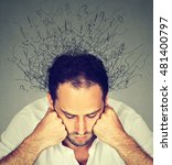 Small photo of Closeup sad young man with worried stressed face expression and brain melting into lines question marks. Obsessive compulsive, adhd, anxiety disorders