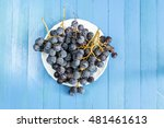 Black Grapes On Blue Background