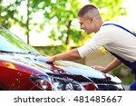 serviceman washing a car | Shutterstock . vector #481485667