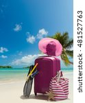 suitcase and big straw hat on... | Shutterstock . vector #481527763