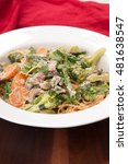 Small photo of vegetable pasta with farm fresh produce in an alfredo sauce and paremsan