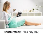 Pregnant Woman Looking At Her...