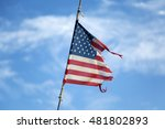 View At Torn American Flag