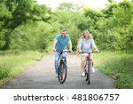 happy couple riding bicycles in ... | Shutterstock . vector #481806757