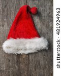 santa fur cap on a rustic... | Shutterstock . vector #481924963