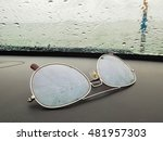 Sunglasses On Console Car With...
