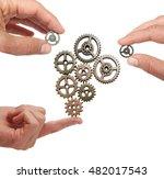 hands putting metal gears... | Shutterstock . vector #482017543