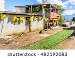 Small photo of San Juan del Obispo, Guatemala - June 26, 2016: Houses adorned with balloons & pine needle carpet in street for St John's Day celebrations in village (near Antigua) named after the patron saint.