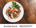 caesar salad with salmon in a... | Shutterstock . vector #482429197
