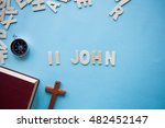 Small photo of Blue background with the Bible book of 2 John