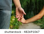 the parent holds the hand of a... | Shutterstock . vector #482691067
