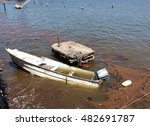 Small photo of Hurricane aftermath: damaged boat