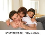 family at home in a sofa | Shutterstock . vector #48282031