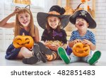 Stock photo happy brother and two sisters on halloween funny kids in carnival costumes indoors cheerful 482851483