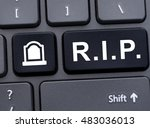 Small photo of Online memorial concept with R.I.P. abbreviation button on computer keyboard