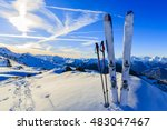Stock photo ski in winter season mountains and ski touring equipments on the top at sunrise 483047467