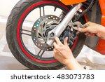 mechanic fixing motocycle  worn ... | Shutterstock . vector #483073783