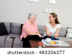 cheerful young girl serving... | Shutterstock . vector #483206377