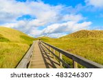 Wooden Walkway To Beach Among...