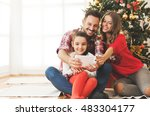 family gathered around a... | Shutterstock . vector #483304177