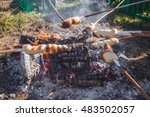 bread on sticks over an outdoor ... | Shutterstock . vector #483502057