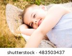 cheerful boy lying down in... | Shutterstock . vector #483503437